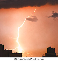 Lightning in the night sky over the city