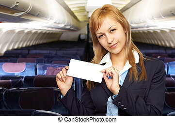 blond air hostess (stewardess) in the empty airliner cabin