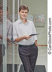Network engineer  in corridor server room