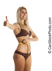 slim woman with a tape measure