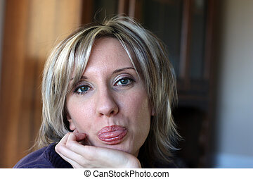 Sticking Tongue Out - A beautiful woman mischievously...