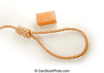 Rope with hangmans noose and soap isolated on white...
