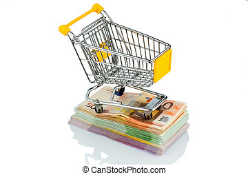 shopping cart on bills - shopping cart is on banknotes,...
