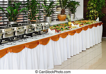 banquet table with chafing dish heaters and canapes