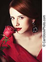 Beautiful redhead women with rose Photo in old color image...
