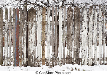 wooden fence at winter - stain wooden fence at snowy winter,...
