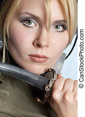 scout blond girl wearing uniform, with knife