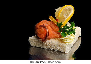 smoked fish canape - canape with smoked fish, lemon lice and...