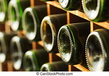 stacked of old wine bottles in the cellar,dusty but tasty