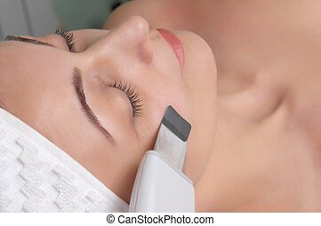 beauty salon series - woman getting ultrasound skin cleaning...