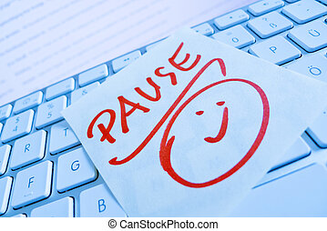 note on computer keyboard: pause - a sticky note is on the...