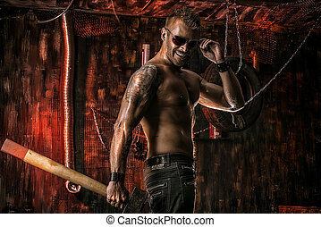 sledgehammer - Handsome muscular man with sledgehammer...