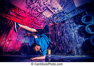 hiphop man - Trendy young man dancer dancing in the old...