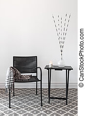 Home decor. Armchair and table with decorations - Home...