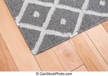 Gray rug on wooden floor - Contemporary gray wool rug on...