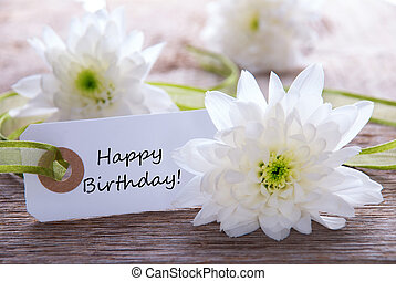Label with Happy Birthday - A White flower Background with a...