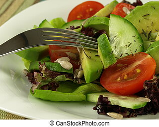 Avocado salad with tomato and cucumber - Closeup of seasoned...
