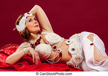 beautiful brunette woman in oriental style clothes