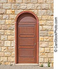 brown door - old brown door in a brick wall