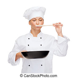 smiling female chef with pan and spoon - cooking and food...
