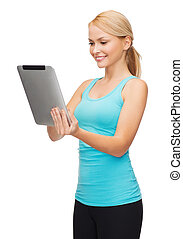 sporty woman with tablet pc - sport, exercise, technology,...