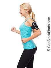 sporty woman running with smartphone and earphones