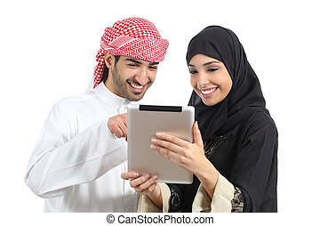 Arab saudi happy couple browsing a tablet reader isolated on...