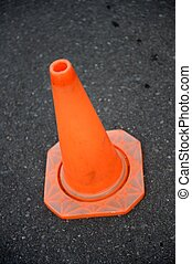 Safety Cone - A close up shot of a safety cone on a road