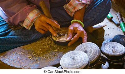Man makes wooden utensils in the workshop. Burma