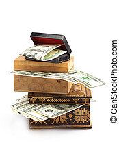 Dollars in the wooden box isolated on white