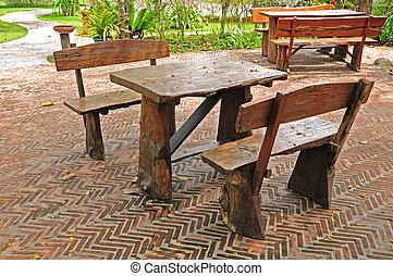 Tables and chairs on brick patio