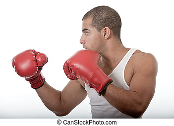 Attractive young man kickboxing