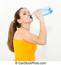 woman drinking water - Young woman drinking water against...