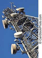 Telecommunications tower with antenna system against the...
