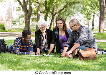 Students With Professor on Campus - Portrait of group of...