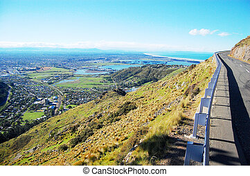 Mountain road turning right town and sea view, Christchurch,...