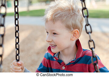 kid at the playground - smiling positive boy at the...