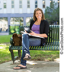 University Student With Book Studying On Campus