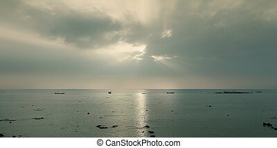 Silhouette of fishing  boat at sunrise in vintage style