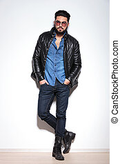 full body picture of a casual man in leather jacket, jeans...