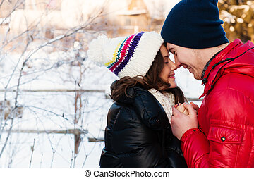 outdoor fashion portrait of young sensual couple in cold...