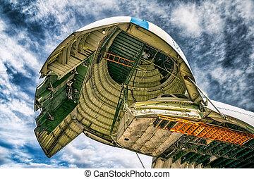 Antonov 225 Mriya - Loading heavy weight cargo to the...