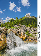 Waterfall and rocks in the Austrian Alps - Picture of a...