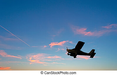 airplane silhouette at sunset - single engine airplane...