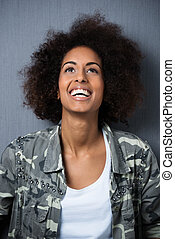 Joyful young African American woman with an afro hairstyle...