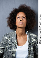Pensive African American woman with an afro - Serious...