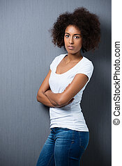 Serious African American woman with an afro - Serious young...