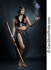 Sorceress woman on dark background