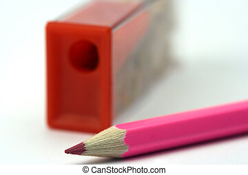 pink pencil and sharpener - A pink pencil and sharpener...
