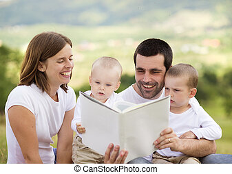 Happy family is reading book - Happy family reading book...